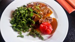 Roasted leg of venison, in September herb sauce, baked herb tomato, green nettle Knöpfle.